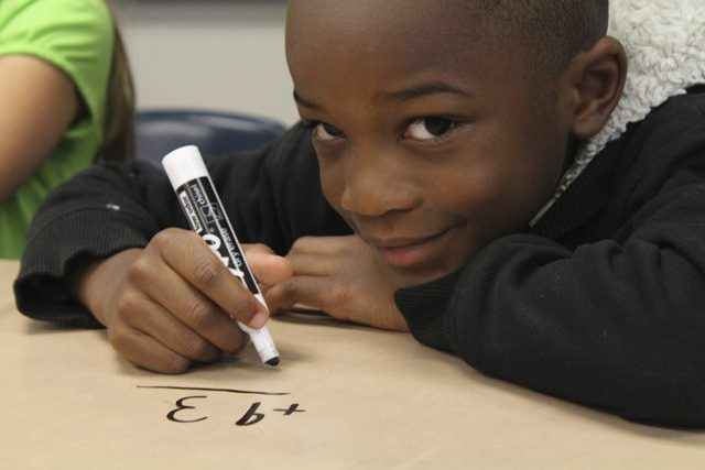 boy smiles as he benefits from an education project funded by Reisert Foundation