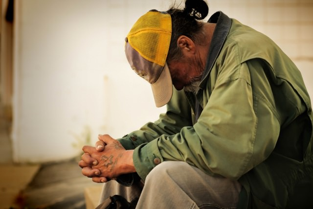 homeless man waiting to be served by a housing project funded by a grant from Reisert Foundation
